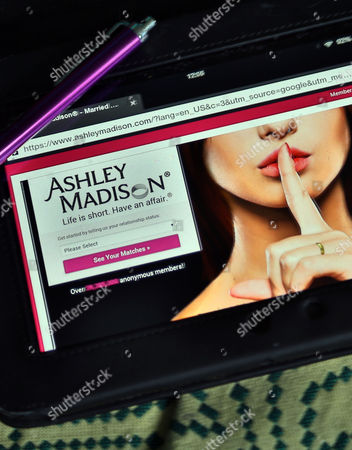 Stock Photo of Ashley Madison website on a tablet device, London