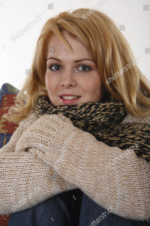 MODEL RELEASED Portait of a young woman, wearing warm clothes