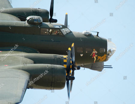 United States Air Force world war two B-17G Flying Fortress bomber named ' Sally B which starred in the film ' Memphis Belle ' famous Hollywood legend Betty Grable artwork adorns the nose at Imperial war museum's Duxford Autumn Airshow Cambridgeshire, Britain.