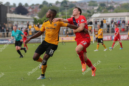 Newport County defender on loan from Wolverhampton Wanderers Aaron Hayden and York City forward Reece Thompson battle for the ball during the Sky Bet League 2 match between Newport County and York City at Rodney Parade, Newport