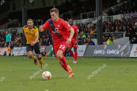 York City forward Reece Thompson chased down by Newport County defender Danny Holmes during the Sky Bet League 2 match between Newport County and York City at Rodney Parade, Newport