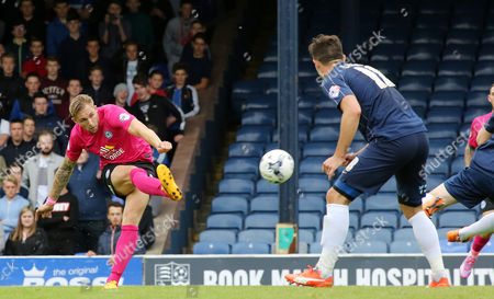 Jack Collison of Peterborough United has a shot cleared off the line