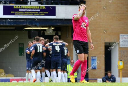 Jack Collison of Peterborough United cuts a dejected figure as Southend United score their second goal