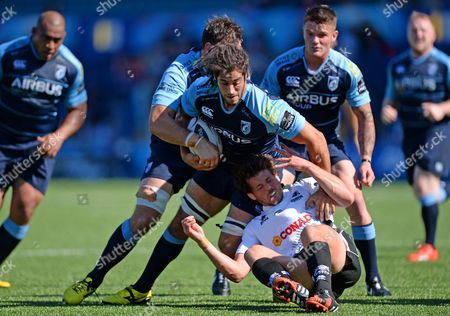 Josh Navidi of Cardiff Blues is tackled by Luke Burgess of Zebre.