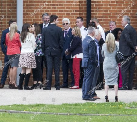 Stock Photo of Max Clifford Attending The Funeral Of His Late Brother Bernie At Crematorium In Morden. 18.08.14.
