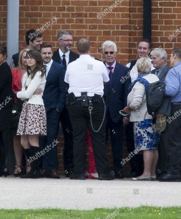 Stock Picture of Max Clifford Attending The Funeral Of His Late Brother Bernie At Crematorium In Morden. 18.08.14.