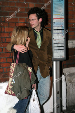 Angela Hazeldine and Sam Stockman hugging at a bus stop