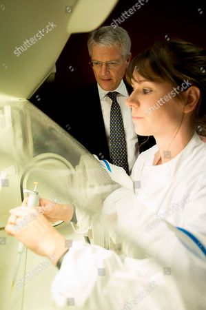 Transport Minister Andrew Jones visits Celtic Renewables as lab assistant Lauren Beck demonstrates equipment they use in the labs