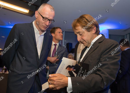 Anthony Seldon signs a copy for Robert Thomson-Chief Executive of News Corp