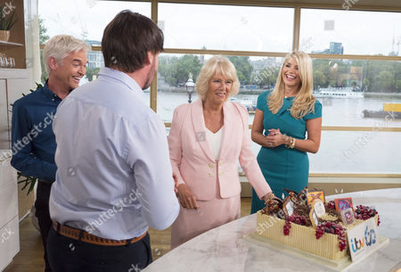 Camilla Duchess of Cornwall meets Phillip Schofield and Holly Willoughby and admires the ITV 60th birthday cake baked by This Morning chef Eric Lanlard