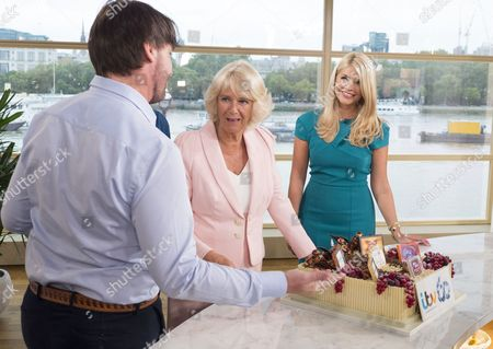 Camilla Duchess of Cornwall meets Holly Willoughby and admires the ITV 60th birthday cake baked by This Morning chef Eric Lanlard