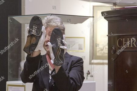 A pair of black leather running shoes worn by Roger Bannister when he broke the record for the 4 mile run are sold at Christies auction for £266,500