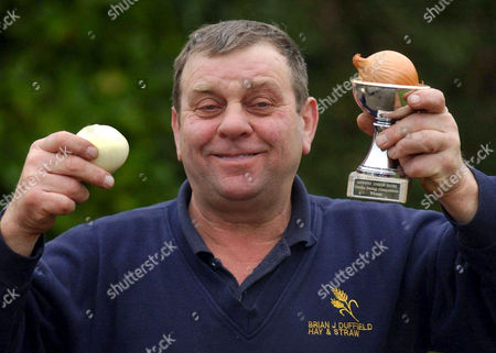 60 Year old Brian Duffield, who holds the world record for eating a raw onion in I minute 32 seconds