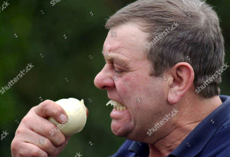 Editorial picture of BRIAN DUFFIELD WHO HOLDS THE WORLD RECORD FOR EATING A RAW ONION, NEWENT, GLOUCESTERSHIRE, BRITAIN- DEC 2004