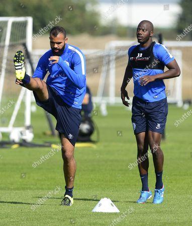 Sandro of QPR high kicks along with Samba Diakite