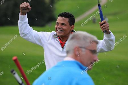 John Salako celebrates finishing the course during the Julian Speroni Testimonial Golf Day at the Surrey National Golf Club, Chaldon