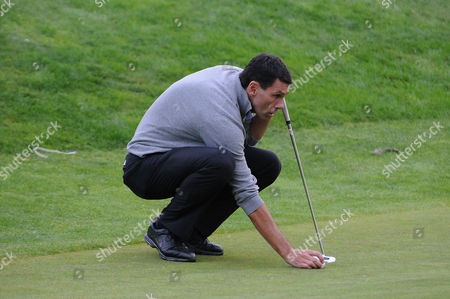 Gus Poyet lines up a shot during the Julian Speroni Testimonial Golf Day at the Surrey National Golf Club, Chaldon