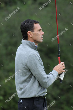 Gus Poyet watches his first tee shot during the Julian Speroni Testimonial Golf Day at the Surrey National Golf Club, Chaldon