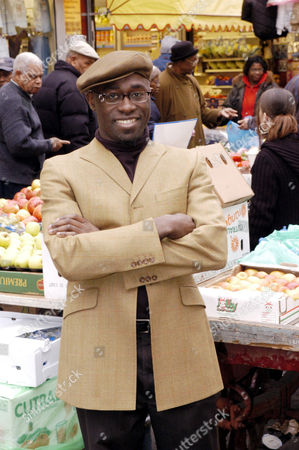 Henry Bonsu in Brixton market. Bonsu has been a Brixton resident for 15 years and comments on developments to have occurred in the area since his arrival.