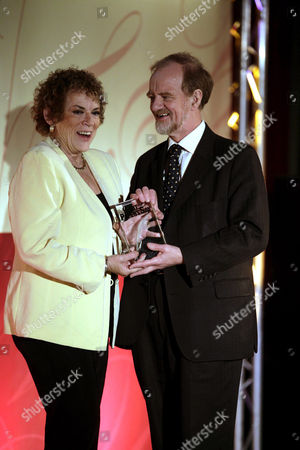 Robin Cook presenting Ann Leslie of The Daily Mail newspaper with the 'Foreign Correspondent of the Year Award'.