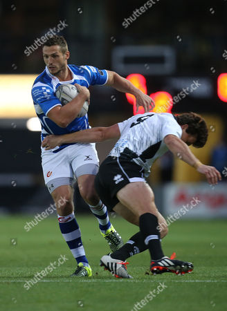 Jason Tovey of Newport Gwent Dragons takes on Luke Burgess of Zebre
