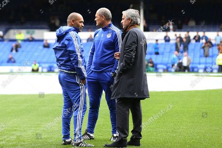 Stock Photo of Chelsea Manager Jose Mourinho chats with Jose Morias, left, and Silvino Louro ahead of the Barclays Premier League clash match between Everton and Chelsea, at Goodison Park, Liverpool