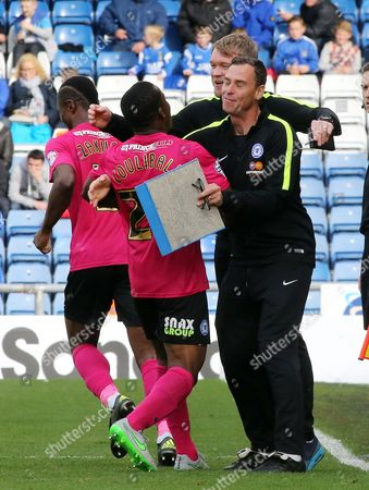 Souleymane Coulibaly of Peterborough United celebrates scoring his first goal with Peterborough United Caretaker-Manager Grant McCann and coach Dave Farrell