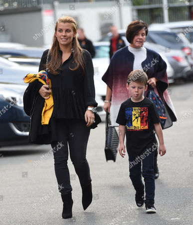 Coleen Rooney arrives at Old Trafford with sons Kai Rooney and Klay Rooney
