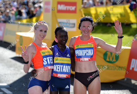 Mary Keitany (centre) winner of the Elite Women's Race poses with second place Gemma Steel (left) and third place Jelena Prokopcuka during the Morrisons Great North Run 2015 at South Shields