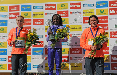 Mary Keitany winner of the Elite Women's Race poses with second place Gemma Steel (left) and third place Jelena Prokopcuka during the Morrisons Great North Run 2015 at South Shields