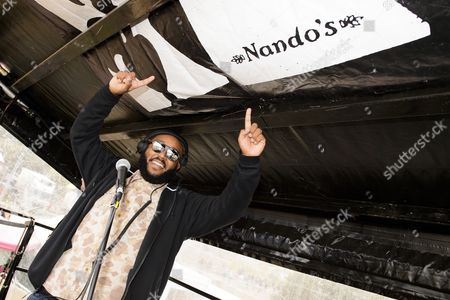 MistaJam performs on top of the Nando's Cock o' Van at Bestival