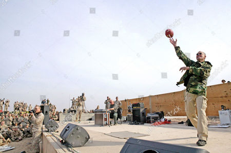 David Letterman tosses footballs to service members during 'The Late Show' at Camp Taqaddum, Iraq. Letterman, along with his musical director Paul Shaffer and stage manager Biff Henderson, brought the popular late night television show to the Marines, sailors and soldiers currently stationed at Camp Taqaddum, Iraq. They were followed with a performance from 'Off the Wall' a southern California band, which added to the holiday festivities.