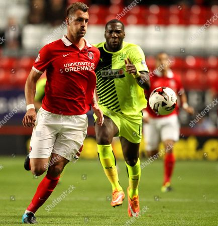 Patrick Bauer of Charlton Athletic is put under pressure by Ishmael Miller of Huddersfield Town