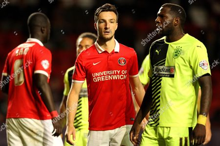 Morgan Fox of Charlton Athletic marks Ishmael Miller of Huddersfield Town