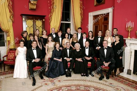 Laura Bush, President George W. Bush, Barbara Bush, and former United States President George H Bush sit surrounded by family in the Red Room. Friends and family joined former President Bush and Mrs. Bush in celebrating their 60th wedding anniversary during a dinner held at the White House. Also pictured are, from left, Georgia Grace Koch, Margaret Bush, Walker Bush, Marvin Bush, Jenna Bush, Doro Koch, Barbara Bush, Robert P. Koch, Pierce M. Bush, Maria Bush, Neil Bush, Ashley Bush, Sam LeBlond, Robert Koch, Nancy Ellis LeBlond, John Ellis Bush, Jr., Florida Gov. John Ellis 'Jeb' Bush, Mandi Bush, George P. Bush, and Columba Bush.