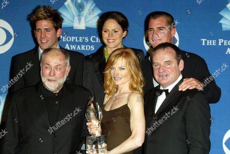 Cast of CSI : Crime Scene Investigation Top row: Eric Szmanda, Jorja Fox, George Eads, Bottom row: Robert David Hall, Marg Helgenberger and Paul Guilfoyle