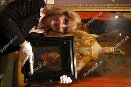 Owner Helen Rappaport with the portrait of Mary Seacole, famous black nurse whose work in the Crimea is often overshadowed by Florence Nightingale.