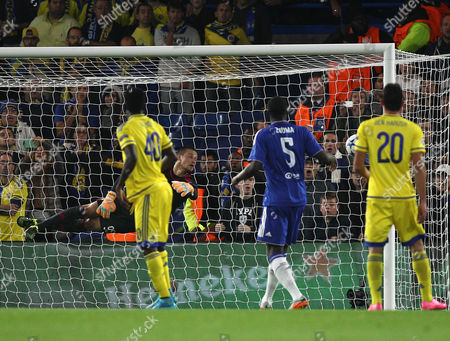 Predrag Rajkovic of Maccabi Tel Aviv is beaten by Willian of Chelsea to make a score 1-0  during the UEFA Champions  League match Group G between Chelsea and  Maccabi Tel Aviv  played at Stamford Bridge stadium , London