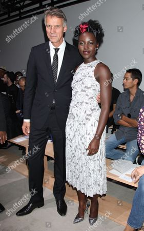 Claus-Dietrich Lahrs, Chief Executive Officer of Hugo Boss and Lupita Nyong'o