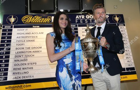 Stock Picture of Robbie Savage with Miss Scotland Mhairi Ferguson with the Ayr Gold Cup -William Hill Ayr Gold Cup draw at Ayr