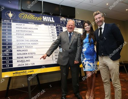 Jim Goldie is happy with his stall 13 draw for his Gold Cup fancy JACK DEXTER with Robbie Savage with Miss Scotland Mhairi Ferguson -William Hill Ayr Gold Cup draw at Ayr