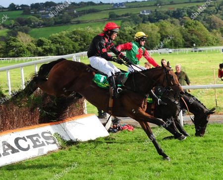Listowel ARCIE MEADE & Danny Howard (near side) jump the last to win the Kevin McManus Beginners Steeplechase as MARVELLOUS MOMENT & Brian O'Connell Part Company. Both were OK after their fall.