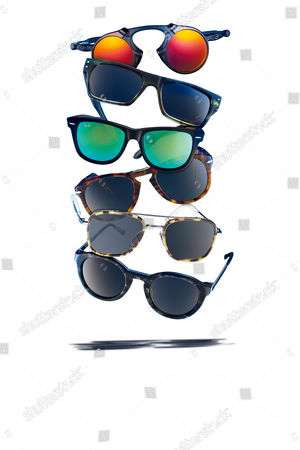 Stock Image of A Selection Of Premium Sunglasses Including (Top To Bottom) Oakley Polarized Madman Our Legacy Faith Ray-ban Original Wayfarer Cosmo Persol Crystal Icons Thom Browne Aviator And Thierry Lasry Zomby