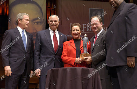 Stock Image of George W Bush, Colin Powell and his wife Alma Powell who received the 'John Thompson Legacy of a Dream Award' during the ceremonies.