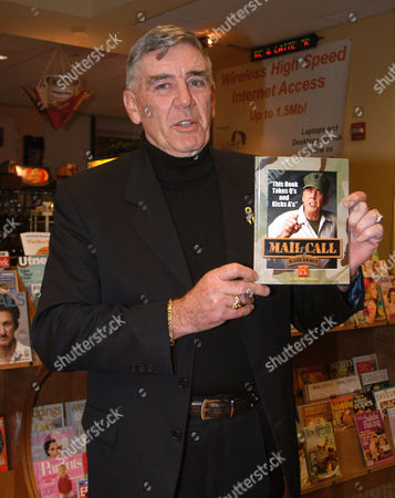R Lee Ermey, an actor and host of the hit tv show 'Mail Call' on the History Channel, holding up his book of the same name.