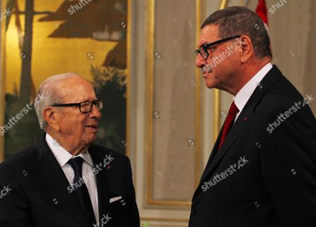 Stock Picture of Tunisian President Beji Caid Essebsi talks with his Prime Minister Habib Essid