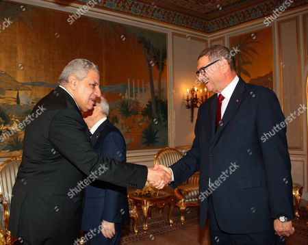 Tunisian Prime Minister Habib Essid shakes hands with his counterpart Egyptian's Ibrahim Mahlab