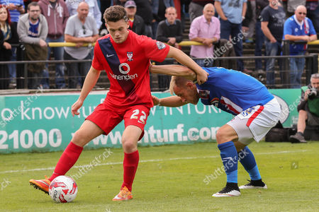 York City forward Reece Thompson and Carlisle United defender Danny Grainger during the Sky Bet League 2 match between York City and Carlisle United at Bootham Crescent, York