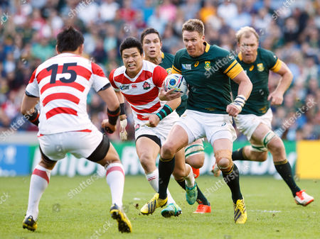 Jean de Villiers takes on Ayumu Goromaru during the Rugby World Cup 2015 match between South Africa and Japan played at Brighton Community Stadium.