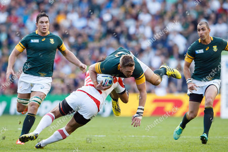Jean de Villiers is sent flying by Ayumu Goromaru during the Rugby World Cup 2015 match between South Africa and Japan played at Brighton Community Stadium.